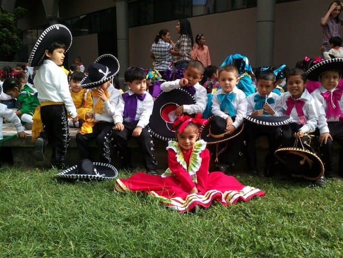 Mexican children performing Mariachi music on Cinco de Mayo