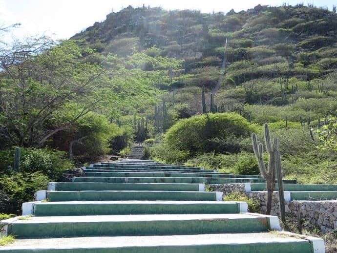 Climbing the Hooiberg Staircase, one of the best Aruba activities for nature lovers