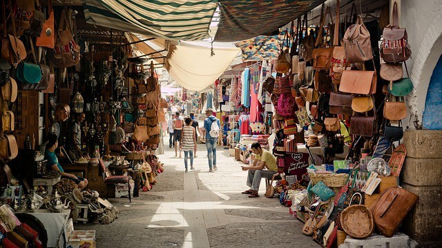 Which country does not celebrate christmas in December -Tunisia, shopping in a Souk