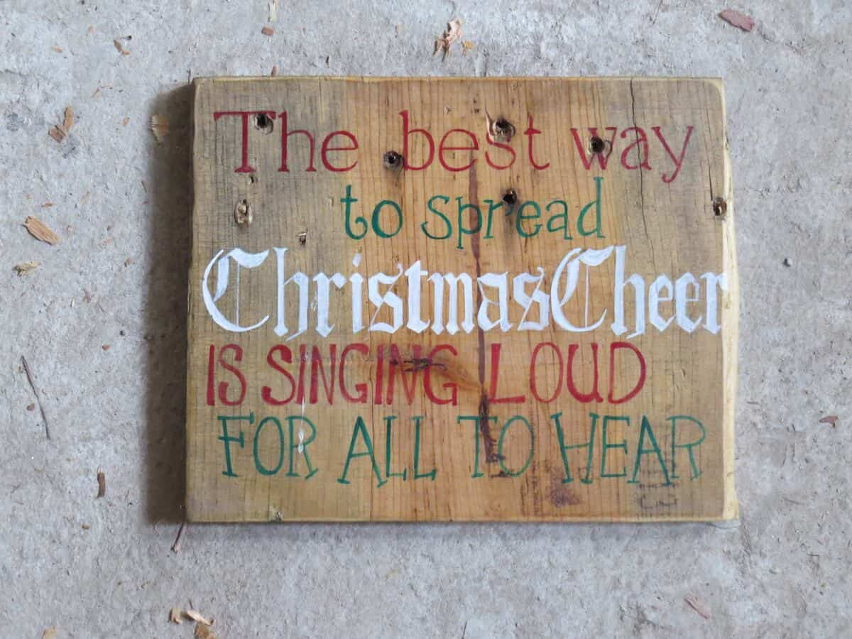 Recycled wood becomes a Holiday Sign full of Christmas Cheer