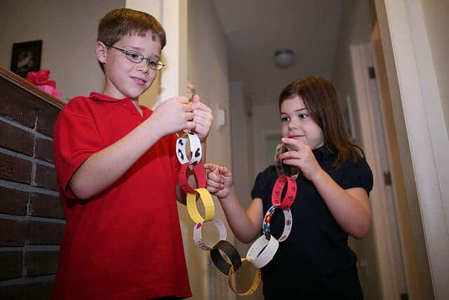 Create Christmas paper chains made out of recycled materials to decorate