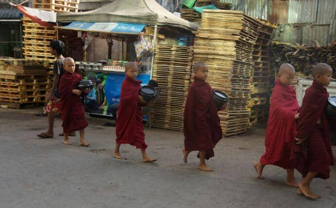 Buddhist in Myanmar -Young Buddhist Monks on alms round