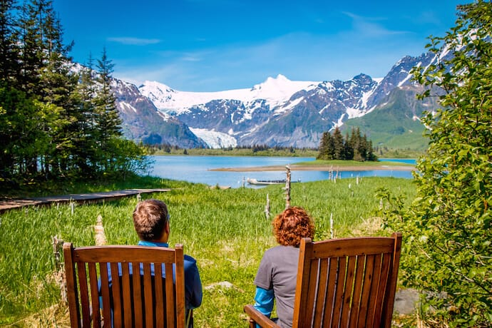 Couple soaking in the scenery at Kenai Fjords Glacier Lodge