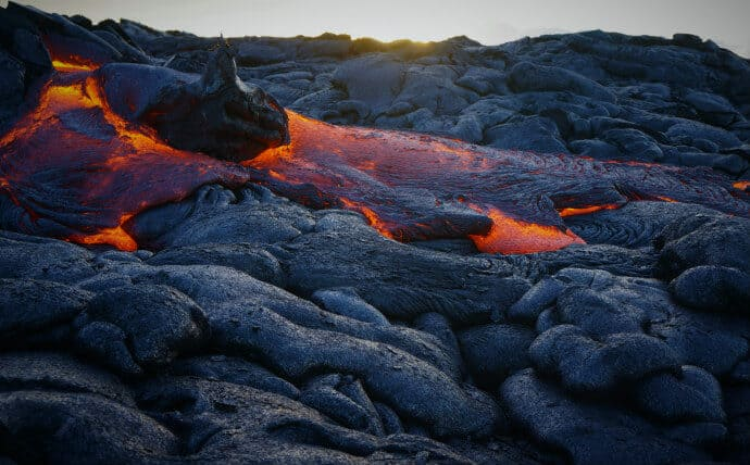 Hot lava flows at Hawaii Volcanoes National Park show the unique geological processes that led to the park becoming a UNESCO natural site