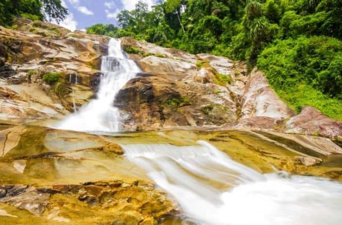 Karom, NamTok Waterfall via Canva