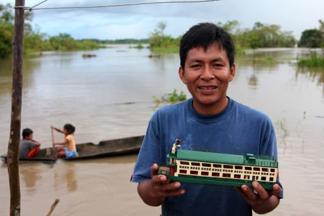 A Peruvian artist shows off his work in the Amazon