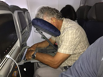 Best Gear for Travelers - Kaz Headrest Airline Pillow on plane