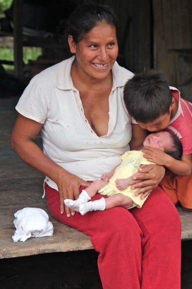 Mother and children in the Peruvian Amazon