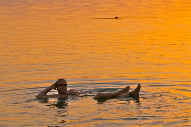 Floating in the Dead Sea at Sunset