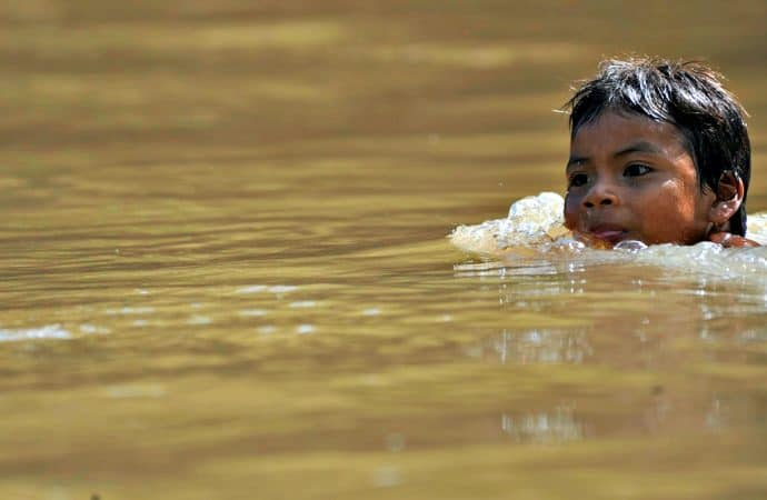 Ecuadorian Amazon Rain Forest Huaorani Child swimming