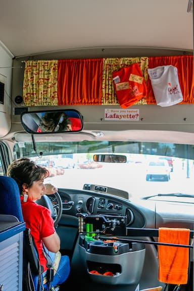 Marie Ducote Comeaux Driving the Cajun Food Tours Mini-Bus