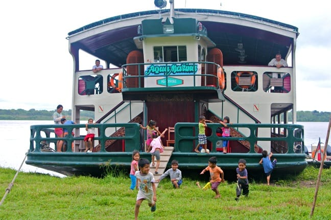 Small Cruise Ships Go Where Big Cruise Ships Can't --village children jump off the back of our amazon river boat.