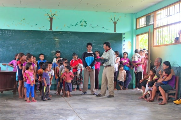 Importance of Ecotourism -International Expeditions Tour Company Donates School Supplies in the Peruvian Amazon