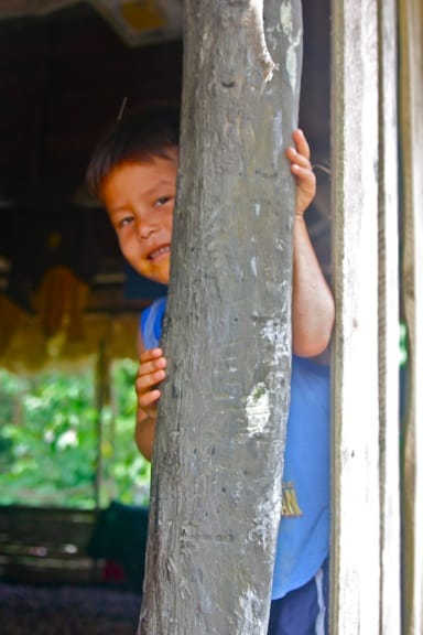 Shy, smiling Ribereños boy in the Peruvian Amazon