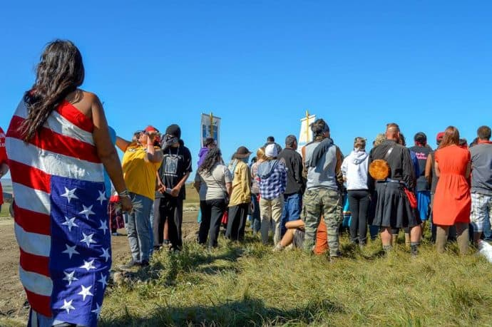 Water Protectors peacefully gather in prayer near the a site of DAPL construction. Photo by Rob Wilson Photography