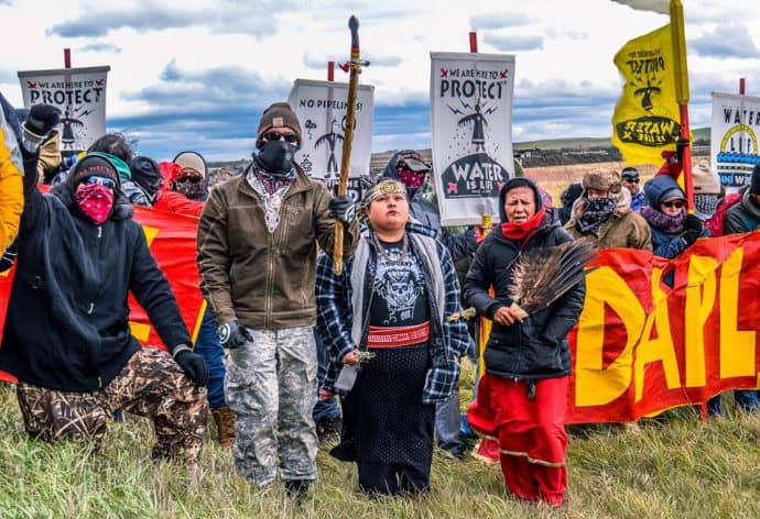 Water Protectors on October 5th 2016 shutting down DAPL construction for the day. Photo by Rob Wilson Photography