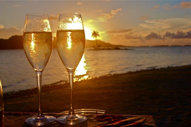 A sunset Champagne toast at the FOur Seasons Resort Bora Bora.