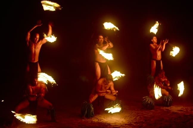 Polynesian fire dancers at Moorea's Tiki Village Theatre