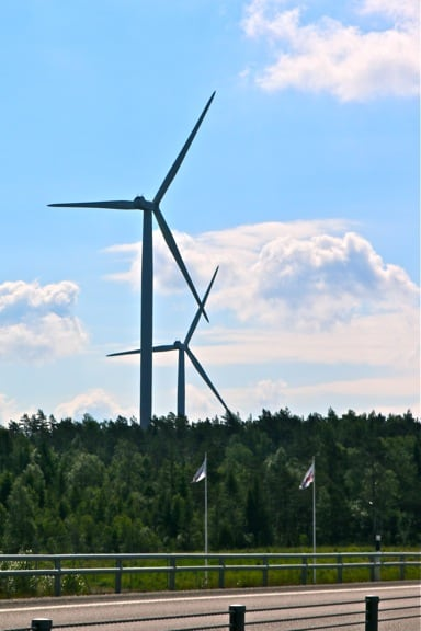 Wind Turbines Dot West Sweden's Highways