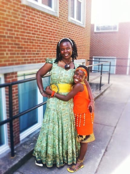 Dorothy Nabwami with an African Children's Choir member
